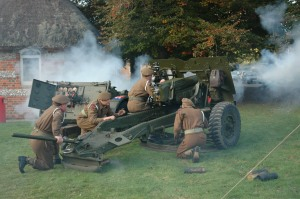 The Royal Artillery World War II Reenactment Group demonstrating a 25-pounder gun on Enham Alamein village green during Alamein Day