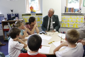 Children interviewing local residents Doug Saunders and Fred Hall